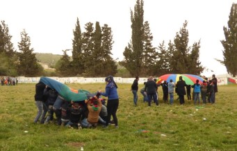 The children of Burin School play parachute games [Credit: EAPPI/E.Pritchard]