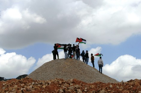 Palestinians demonstrate on land confiscated by the Israeli authorities in the village of Wadi Foukin [Credit: M. Whitton]