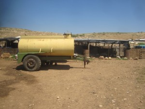 Najoum's water tank of 3 cubic meters. Credit: EAPPI/P Hughes