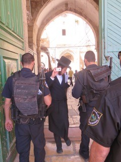 A Jewish man being asked to leave the Compound. Photo/EAPPI.S.Horne