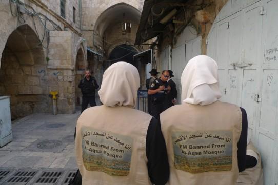 Last week 2 women demonstrators observe an attempted incursion. Photo/EAPPI N.Oom