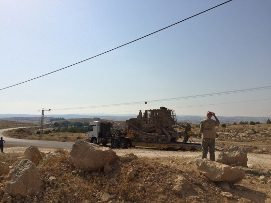 20150702 - Susiya - Truck with bulldozer parked outside of Susiya and EA - AndersForsberg