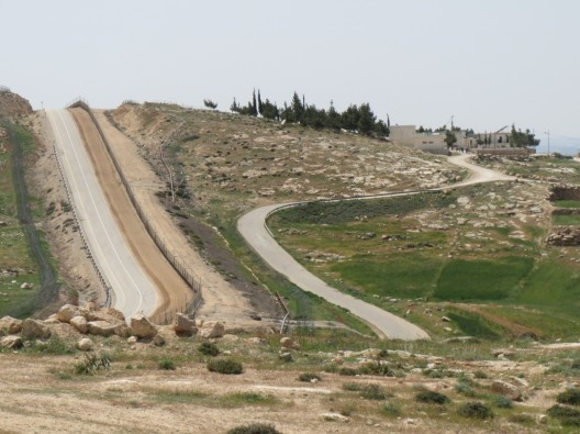 The road to Imneizil school from Beit Yatir Checkpoint on the right. You can see part of the Separation Barrier following the edge of the road on the left [Photo: EAPPI/T.Mansbridge]