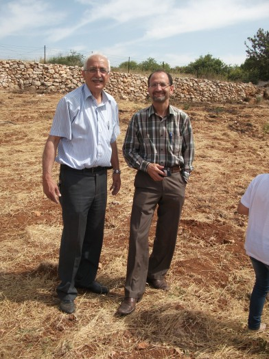 Nasser and Hamed celebrating  cleared land. Credit EAPPI  ERStrachan