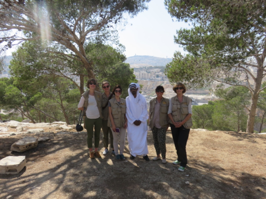 "Attalah stood with Sandra and the new Jerusalem EAs on top of the ""Hill of the Pope"" next to his community [Photo: EAPPI/S. Horne]"