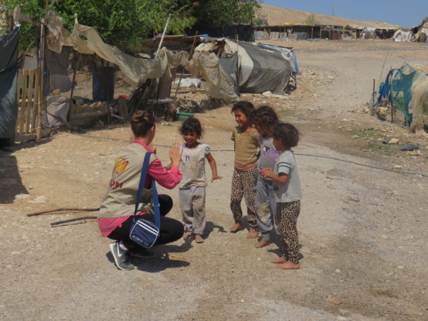 In July, EA Marie plays with the children. PhotoCredit:EAPPI:S.Horne