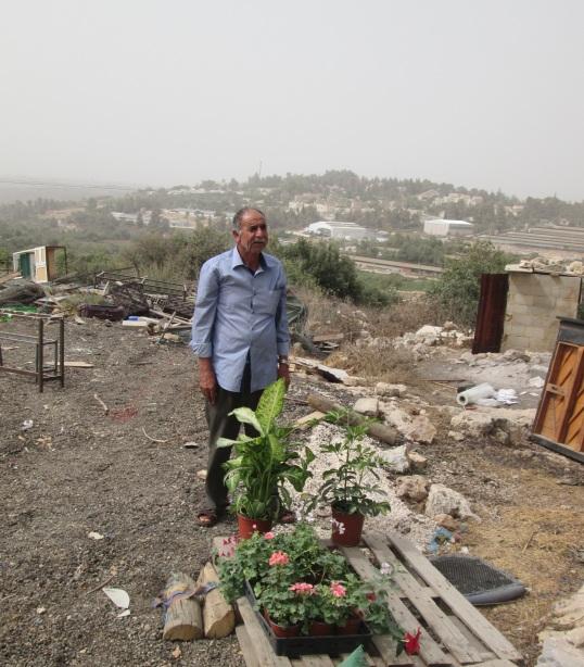 7.9.2015 Said with the remnants of his flower stock, Sakariya EAPPI.E.ODriscoll