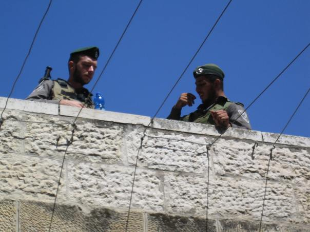 Soldiers overlooking the Old City in Jerusalem [Photo: EAPPI/E Brightwell]