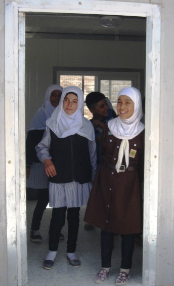 Saja and friends in the entrance to their classroom Photo: EAPPI/A.Davison