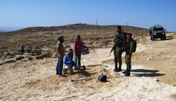 soldiers put a stop to road repairs