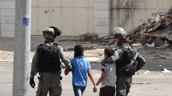 [EAPPI] - Two young boys are detained in Hebron and taken to the police station after being ambushed by soldiers as they are suspected of throwing stones