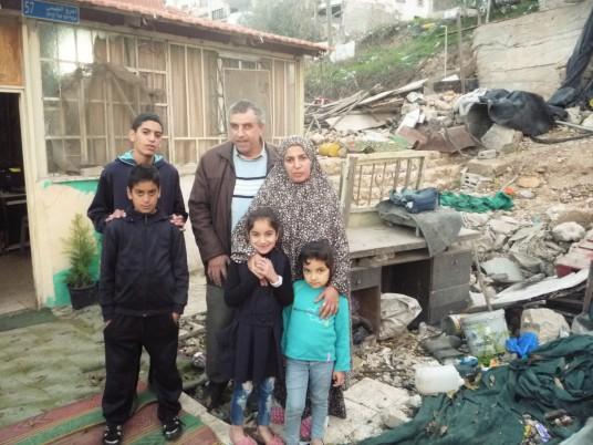 Nureddin, Nabeha and their children. {Photo: EAPPI/K.Cargin]