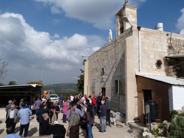 The congregation outside Iqrit church after mass [Photo: EAPPI/V.Pasteur]
