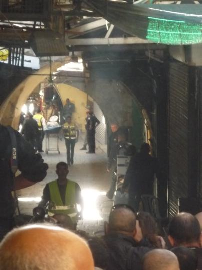 29.11.15 body of man shot in Old City being taken away. Photo EAPPI.K.Cargin
