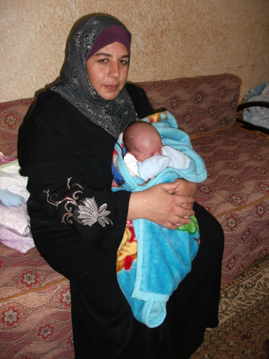 Noura and baby Ibrahim [Photo: EAPPI/E.Strachan]