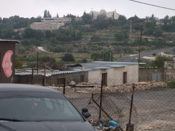 Some Beit Zakariya houses with the Israeli settlement of Gush Etzion in the background [Photo: EAPPI/E.Strachan]