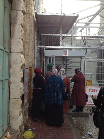 Palestinian teachers entering Shuhada Street through checkpoint 56 [Photo: EAPPI]