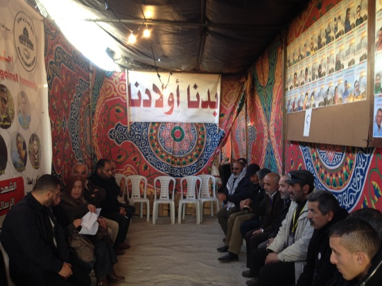 Picture A Palestinians gathered at a solidarity tent in Hebron demanding the release of the body of their children [Photo: EAPPI]