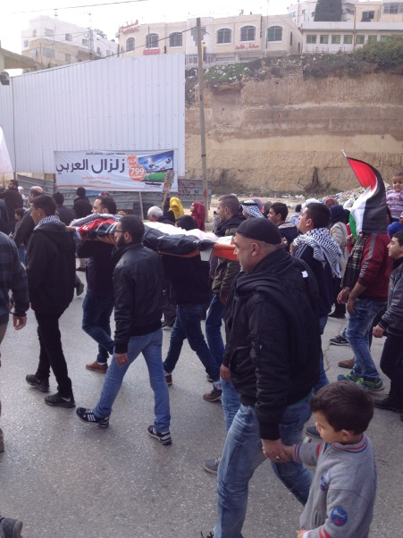 Picture B Palestinians protesting against new policy approved by Israel's security cabinet [Photo: EAPPI]