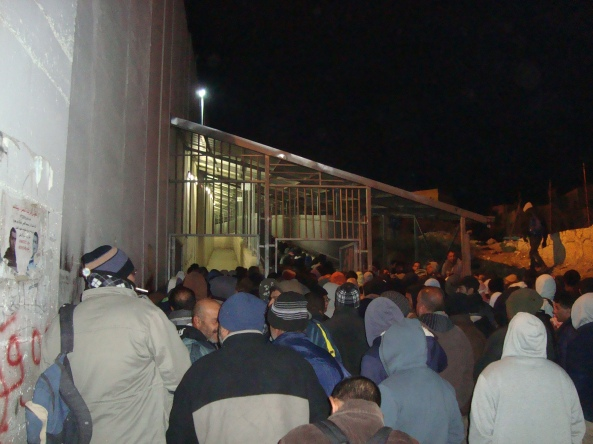 2 27.12.15 Bethlehem, CP300. Workers start crowding at entrance at 4am. Photo EAPPI. A.Lie