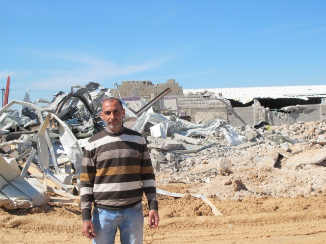 Mohammed in front of his demolished business. Photo: EAPPI EA Marie