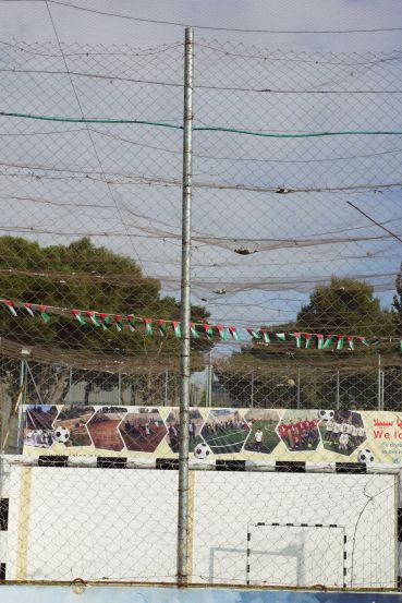 Bethlehem Aida Camp Tear Gas Canisters in the netting above the football pitch EAPPI I Neiva