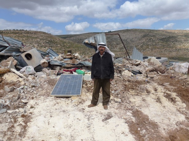 Photo 4 Mohammad Kehala and his demolished home and solar panel, Rammun. (photo EAPPI/ S. Faaberg)