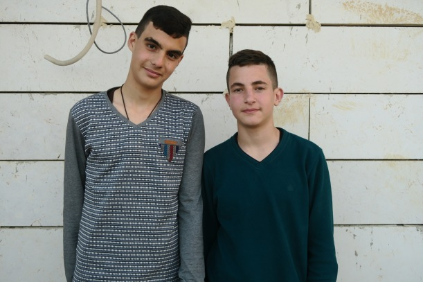 Tariq (right) and his best friend outside Tariq's house. Photo EAPPIAKaiser