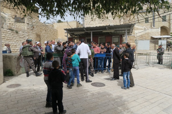 Worshippers held up as they exit the Ibrahimi mosque. Photo EAPPIAKaiser