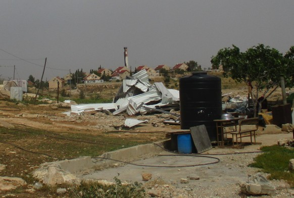 10.04.16 Um al Kheir demolition with Israeli settlement in the background Photo EAPPI E.Waddington