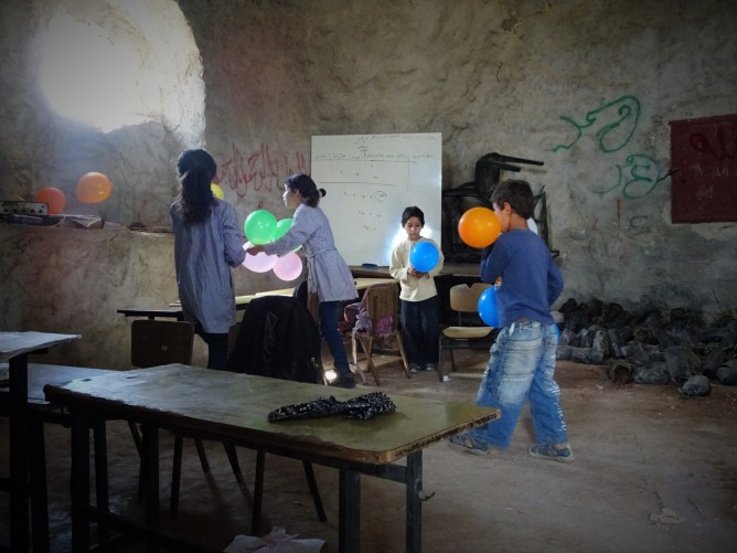 Photo 3. A Child in Time A Child in Place: Khirbet Tana children in their makeshift school.