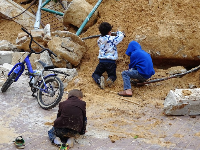 Photo 4. A Child in time A Child in Place: Za'tara, children playing in the ruins of their Belgium funded playground. (Photo: EAPPI A. Holmes)