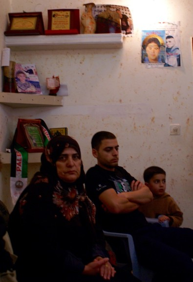 Photo 2: Mother of Omar al Jawabreh, with her son and grandson.