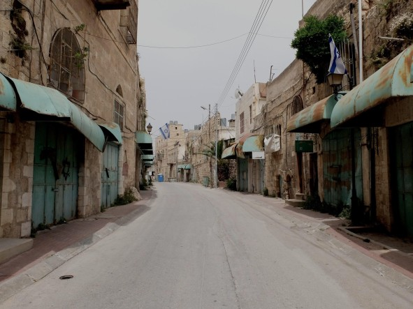 Shuhada Street; deserted since it has been closed down since the 1990s and now part of the CMZ. Photo: EAPPI. E.Richardson