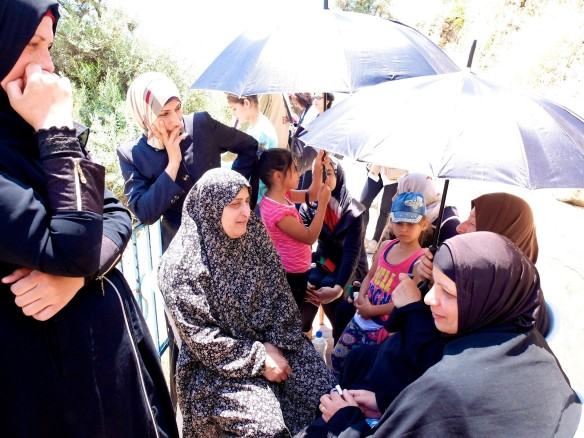 Women and children staged a sit-in protesting restricted access of movement in CMZ. Photo: EAPPI. E.Richardson