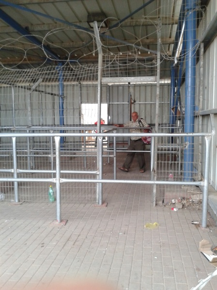 26.6.2016 nearly 7am at Meitar Checkpoint - one man walks through the rails Photo EAPPI MHuff