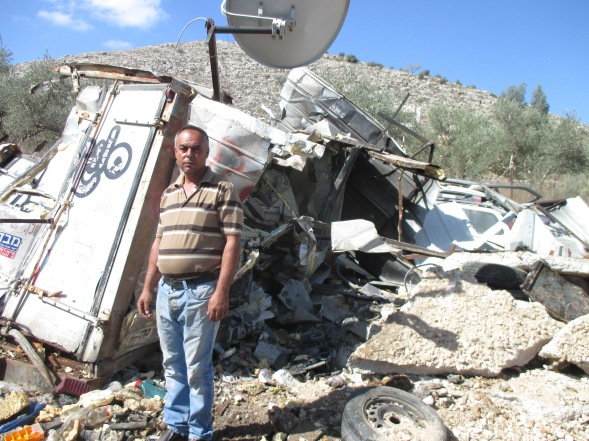 Mohamed in front of his demolished shed [Photo: EAPPI/Noirin]