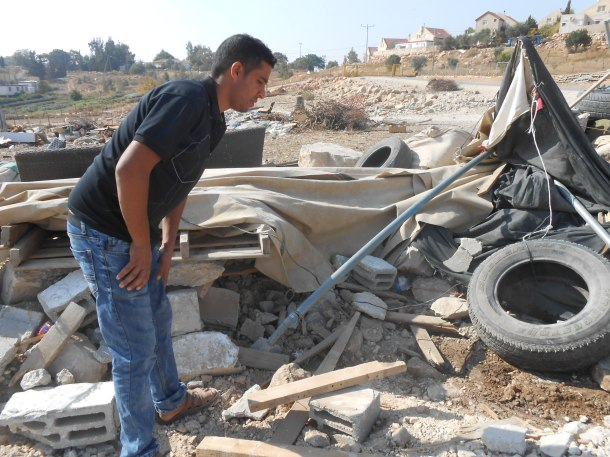 Resident looks at demolished tent used as temporary community centre, Umm al-Khair Photo:EAPPI/Liz