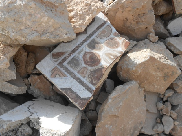 Bits of tiled floor from the two-year-old community centre are still visible in the rubble. Photo:EAPPI/Liz