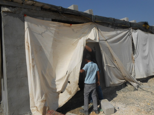 A recently-built house remains under wraps in the hope of hiding its construction from the drones the settlers use to check every move the Palestinians make. Photo:EAPPI/Liz
