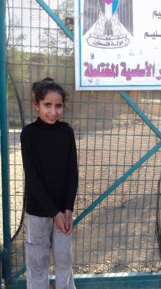 Nisveen, outside the school gates