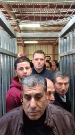 Men queue to enter Qalandiya checkpoint Photo:EAPPI/Dave
