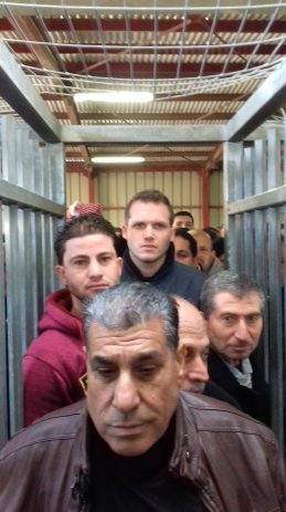 Men queue to enter Qalandiya checkpoint Photo:EAPPI/Dave