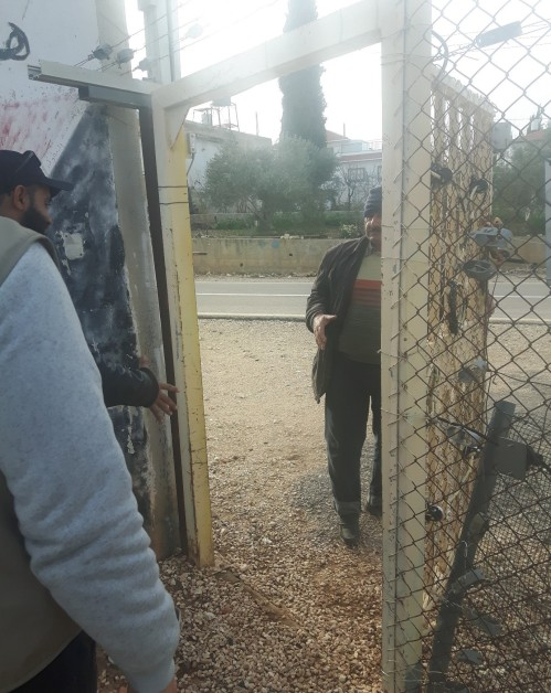 Hani opens the gate. Photo: EAPPI/John