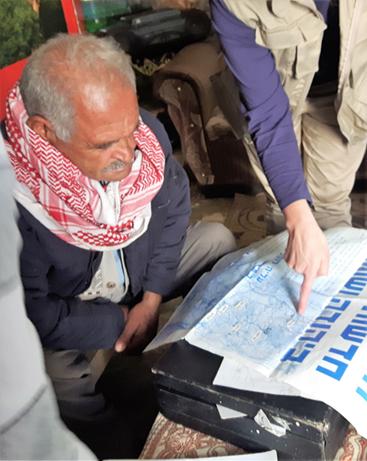 Abu Omar outlines the geography of Shufa. Photo: EAPPI/John