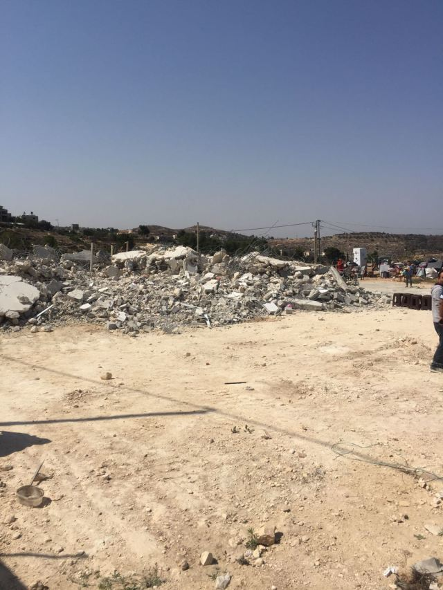 The rubble of Ilham's house.jpg